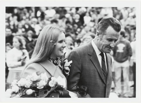 1969_Homecoming_Queen_Betsy_Maher_and_her_father_during_Homecoming_festivities